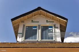 Dormer Building Dormer Windows On Roof Of Building Under Construction Stock Photo