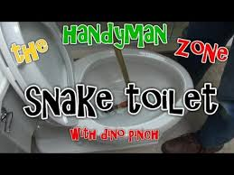 clear clogged toilet using closet auger or snake youtube