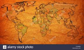 Vintage World Map by Western Sahara Flag On Old Vintage World Map With National Borders