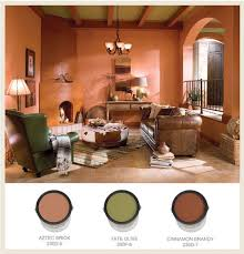 love the color palette in this sunken spanish and pueblo style den