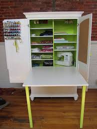 diy craft armoire with fold out table dreaming of my dream craft room ribbon holders thread spools and
