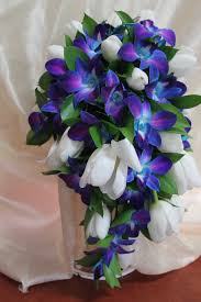 wedding flowers wi blue purple dendro orchids white tulips cascading wedding