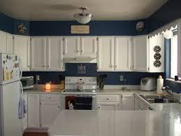 decorating ideas for kitchen walls blue wall color with classic white kitchen cabinet for