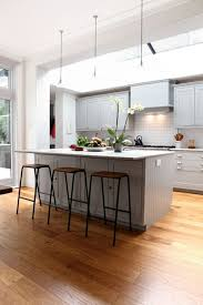 triangular kitchen island cream wall cabinets storages brown wooden kitchen islands