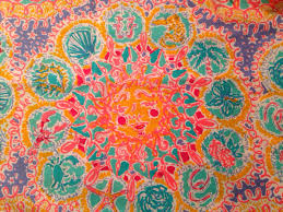 3 square patches of lilly pulitzer fabric written in the sun