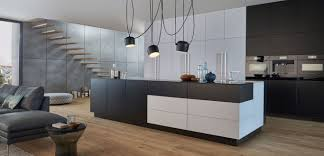galley kitchen with island layout wooden laminated flooring light