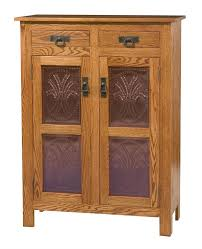 amish mission style two door cabinet with copper paneling