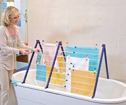 naturally dry your clothes indoors with these helpful products leifheit pegasus bathtub dryer 190