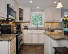 Antique White Kitchen Cabinets by Black Appliances And White Or Gray Cabinets U2013 How To Make It Work