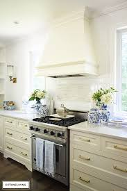white kitchen cabinets with gold pulls new brass hardware pulls and faucet citrineliving