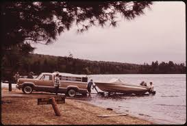 Vintage Ford Truck Camper - file boater uses his pickup truck camper to pull his outboard