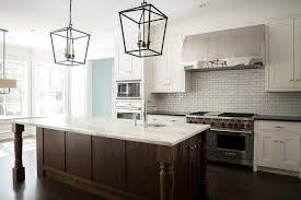 lovely kitchen features white shaker cabinets paired with black