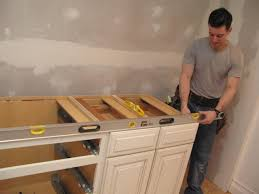 how to paint your kitchen cabinets like a professional how to refinish cabinets like a pro hgtv