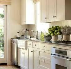 Small Long Kitchen Ideas Glass Front Wall Cabinet White Quartz - Quartz backsplash