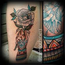 hand holding a rose by zack taylor evermore tattoo los