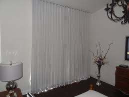 custom ripple fold sheer drapes and a second layer of blackout