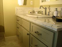 top and marble tile back splash the vanity was painted a medium