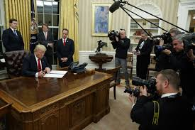 in first oval office appearance trump takes symbolic step on