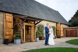 a classic countryside wedding at the tythe barn bicester with