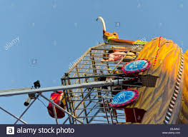 children inside a cage of a pirate ship amusement ride gondola