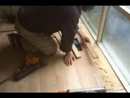 installing oak unfinished hardwood flooring to the