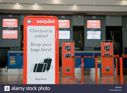 check in desk sign easyjet check in desks with sign for bag drop stock photo 29069017