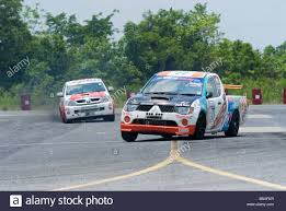 mitsubishi pickup trucks mitsubishi and toyota pickup trucks racing on a racetrack in