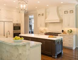 kitchen with black island and white cabinets contrasting cabinets karr bick kitchen bath