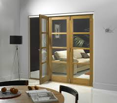 green tinted glass wall with frosted sliding door interior most