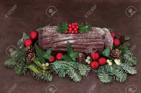chocolate yuletide log with bauble decorations