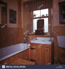 blind on frosted window above basin in pine vanity unit in pine