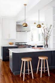 best ideas about navy kitchen pinterest all white kitchen with gold pendant lights
