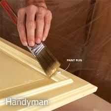 Touch Up Kitchen Cabinets How To Spray Paint Kitchen Cabinets Family Handyman