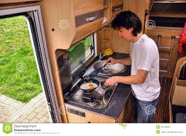 man cooking in motorhome rv interior royalty free stock