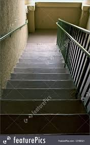 architectural details looking down dark muted stairwell stock