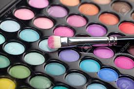 a close up image of a eye shadow set with a professional makeup