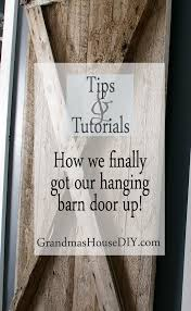 we finally got our hanging barn door up grandmas house diy hanging barn door country home tutorial diy do it yourself tutorial