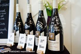 wine wedding guestbook guests sign the bottle of wine for the