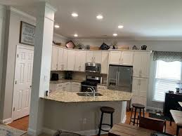 how to restain cabinets a different color should i re stain or paint my cabinets hometalk
