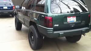 lifted jeep grand cherokee lifted jeep grand cherokee w flowmaster exhaust youtube