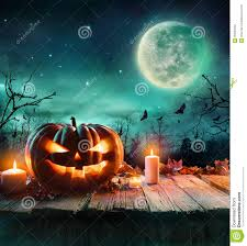 halloween pumpkin in a spooky forest at night stock photo image