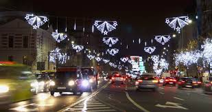 christmas street lights and night traffic in romania stock footage