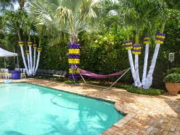 lovely backyard party decorations around clear water pool and tile