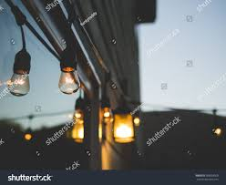 romantic outdoor ambiance decorative string lights stock photo
