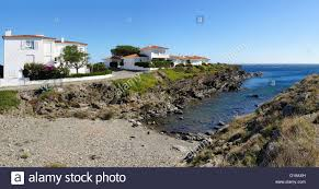 panoramic view over a cove with mediterranean houses in the