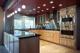 kitchen recessed lighting design with tile flooring and dark
