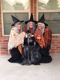 Halloween Decorations Using Milk Jugs - three sister witches made out of plastic milk jug halloween