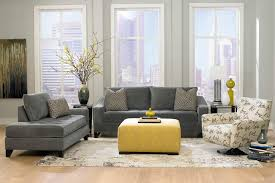 small gray velvet sectional sofa mixed yellow upholstered puff and