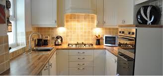 ivory kitchen ideas falstone ivory kitchen with oak block laminate worktops kitchen
