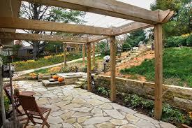 Flagstone Patio With Pergola Pergola Outdoor Kitchen Forever Green Iowa City Coralville